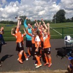 U13s receive the cup from NIWFA chairperson Sue O'Neill