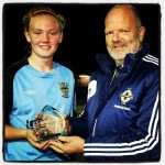 Jacqueline Burns receiving her player of the match award from Roy Cathcart IFA