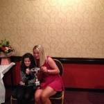 Claire receives her award from Nicole Hamilton