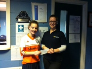 Grace Downey receives the prize money from Mid Ulsters Rachael Rodgers