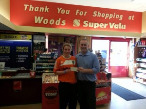 Captain Claire Rooney receives sponsorship for the game from Phillip Woods Super Valu in Richhill