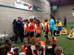 the girls receive their medals from Joe McAree