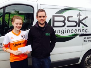 Rachael Rodgers accepting sponsorship from Barry Kerr BSK engineering
