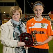 Chloe receives player of the match award from Christine Scott Danske Bank